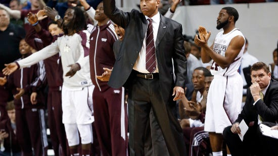 Mississippi State coach Rick Ray signals a play in the final seconds of the second half of his team's NCAA college basketball game against Texas A & M in Starkville, Miss., Saturday, Jan. 18, 2014. Mississippi State won 81-72 in overtime. (AP Photo/Rogelio V. Solis)