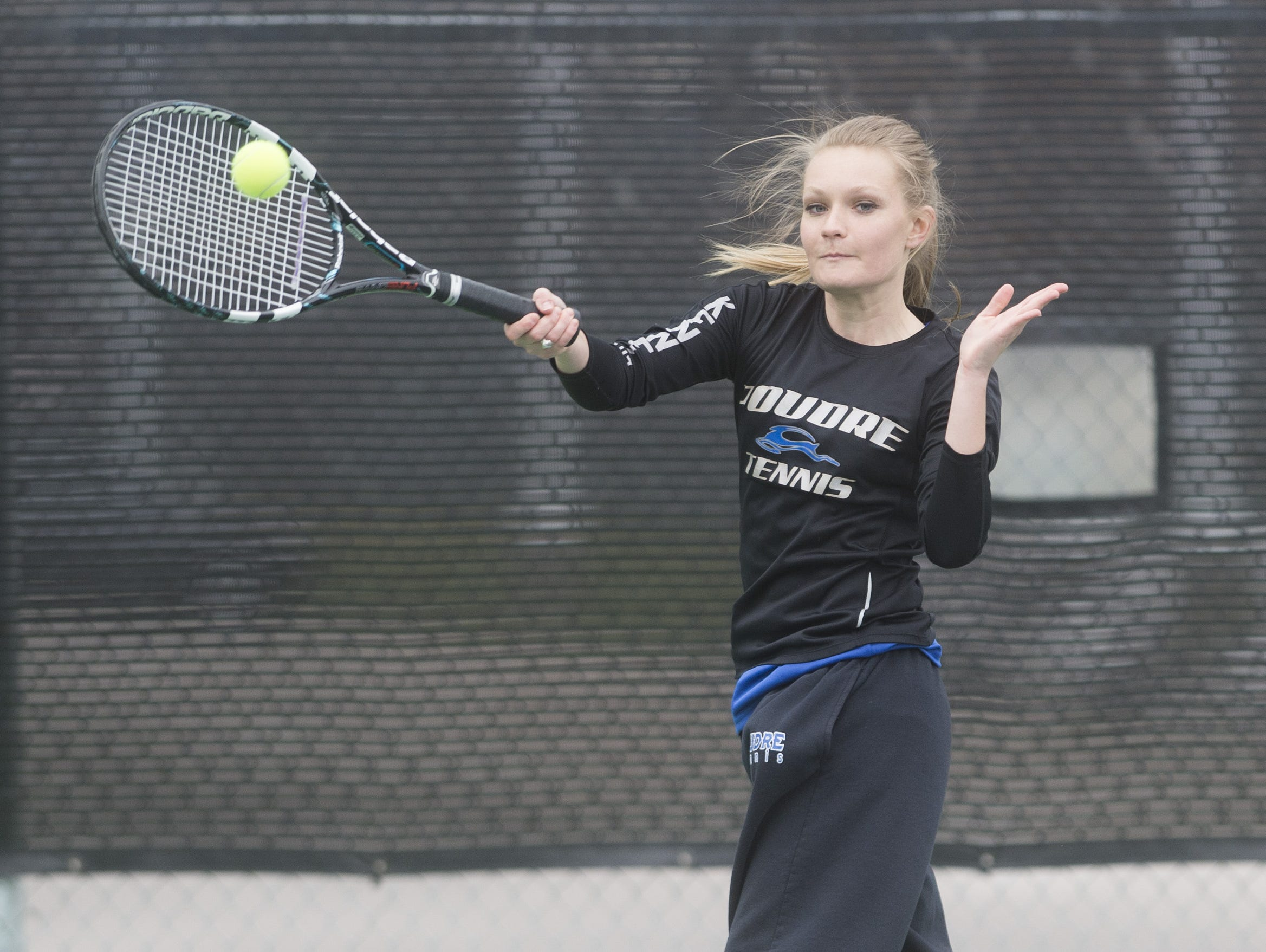 Emily Kenney of Poudre takes on a Rocky Mountain High School doubles team during a match Tuesday, March 29, 2016.