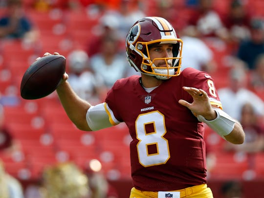Washington Redskins quarterback Kirk Cousins throws to a receiver in the first half of a preseason NFL football game against the Cincinnati Bengals, Sunday, Aug. 27, 2017, in Landover, Md. (AP Photo/Alex Brandon)