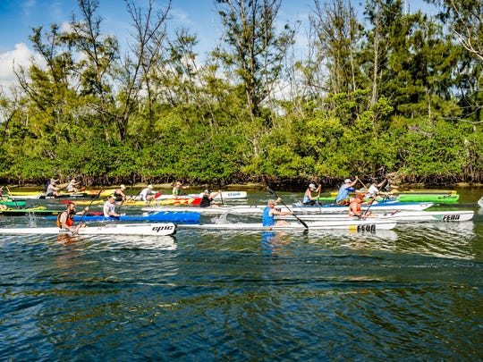 The first wave of racers begins with the OC-1, OC-2, Surfski and Kayaks.