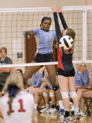 D.W. Daniel's Adria Oliver spikes the ball in a match