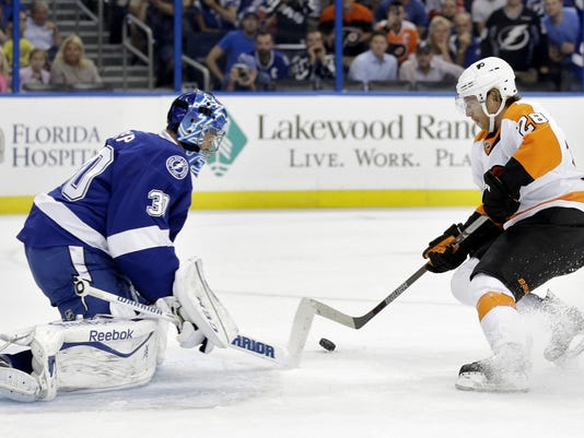 Philadelphia Flyers center Claude Giroux (28) loses control of the puck as he moves in on Tampa Bay Lightning goalie Ben Bishop (30) on a first-period penalty shot during an NHL hockey game Thursday, Oct. 8, 2015, in Tampa, Fla. (AP Photo/Chris O'Meara)