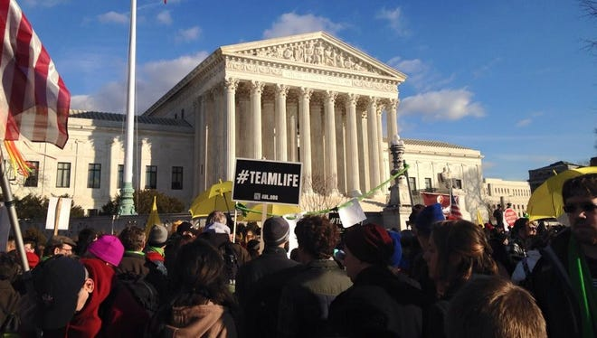 Anti-abortion protesters gather outside the U.S. Supreme Court in 2015 for the March for Life.