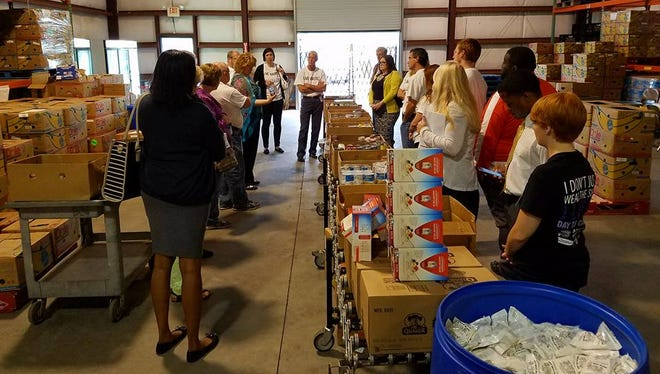 A site visit by last year's donor panelists at Manna Food Pantries.