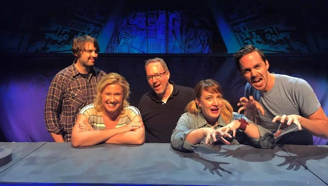 "Joel Hodgson, middle, and the cast of ""Mystery Science Theater 3000"" joke around with Kate Green, front left, before the touring show Aug. 6 at the Weidner Center. Green, who is the manager of the Ashwaubenon Performing Arts Center, brought Hodgson, a graduate of Ashwaubenon High School, a bag of goodies from his alma mater."