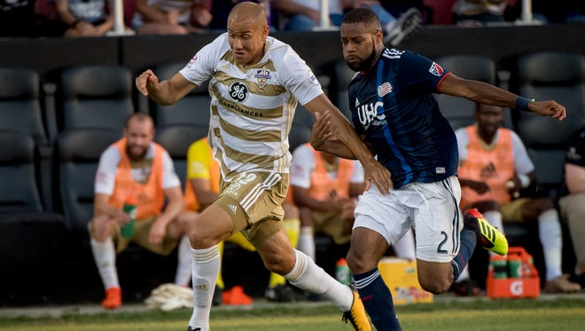 Louisville City FC forward Luke Spencer (12) plays against New England Revolution defender Andrew Farrell (2) during the game played at Lynn Stadium in Louisville, Ky, June 5, 2018.