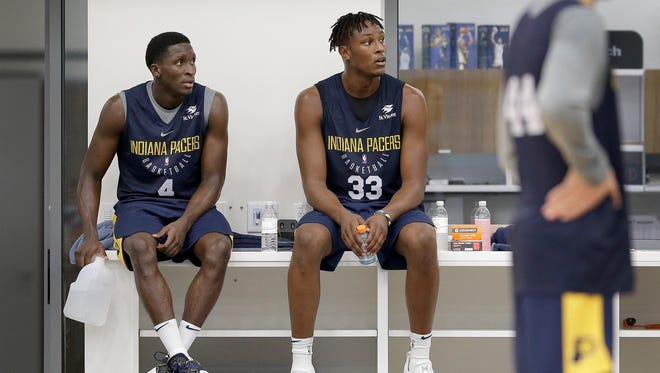 Indiana Pacers guard Victor Oladipo (4) and center Myles Turner (33) wait for their turn during Pacers practice at the St. Vincent Center on Tuesday, Sept. 26, 2017.