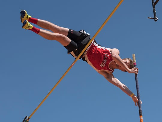 Canton's Andrew Koenigsknecht clears the bar during