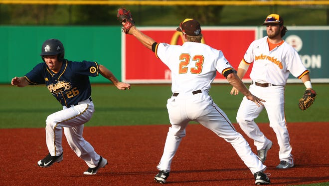 The Aviators' Aaron Bence avoids a tag to reach third base.
