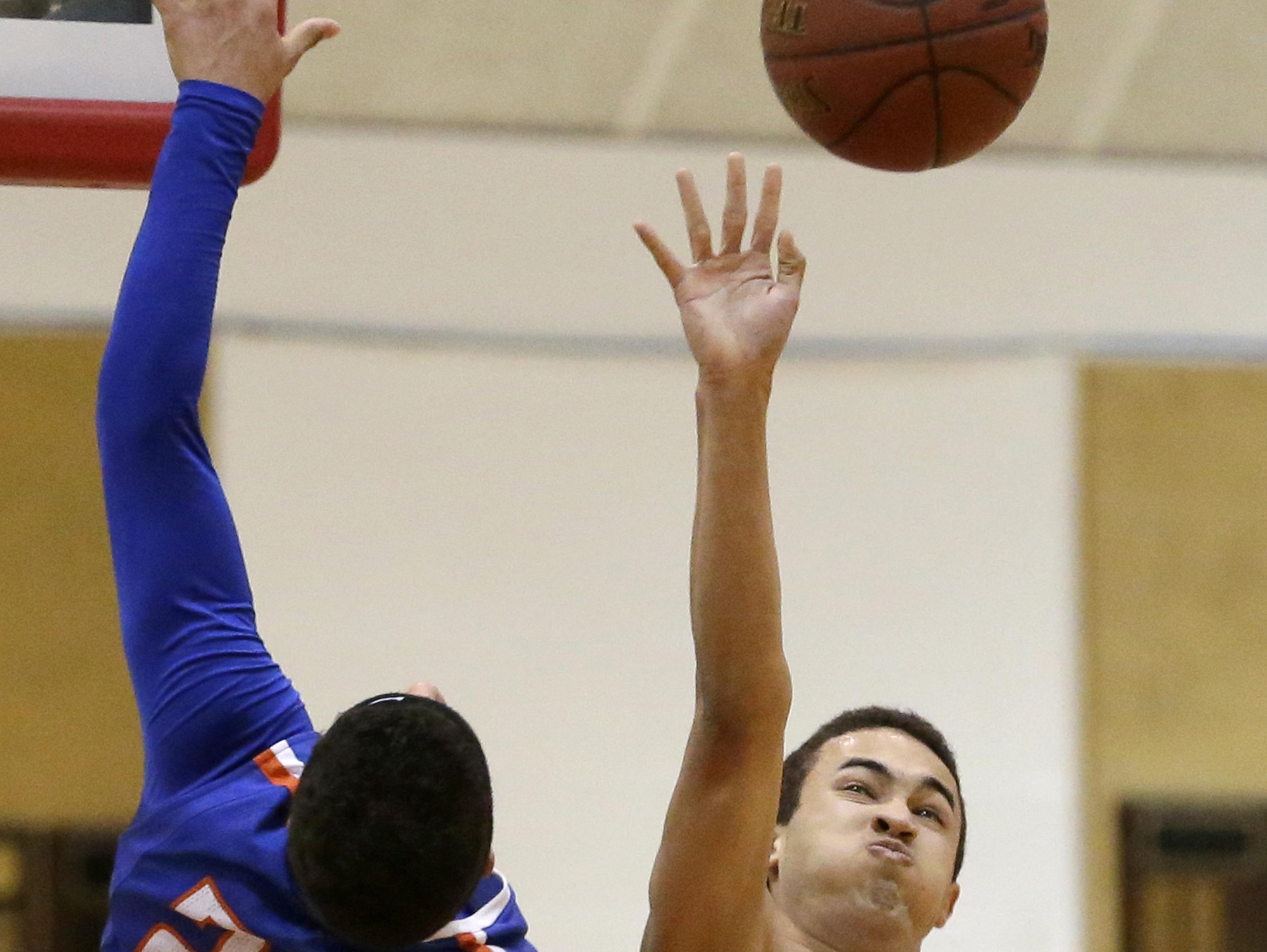 Neenah's Zavier Sims (right) knocks the ball away from Appleton West's Jeason Thomas during Friday's game in Neenah.