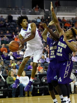Dru Smith of University of Evansville looks for an open teammate after going airborne against Alcorn State during the first half at the Ford Center in Evansville Monday.
