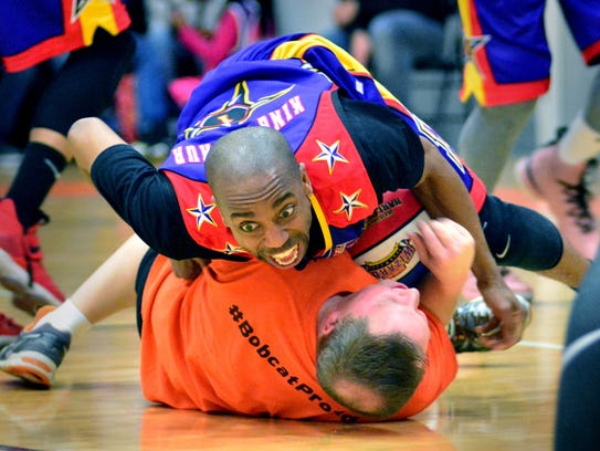 "The Harlem Wizards' King Arthur ""fouls"" Northeastern"