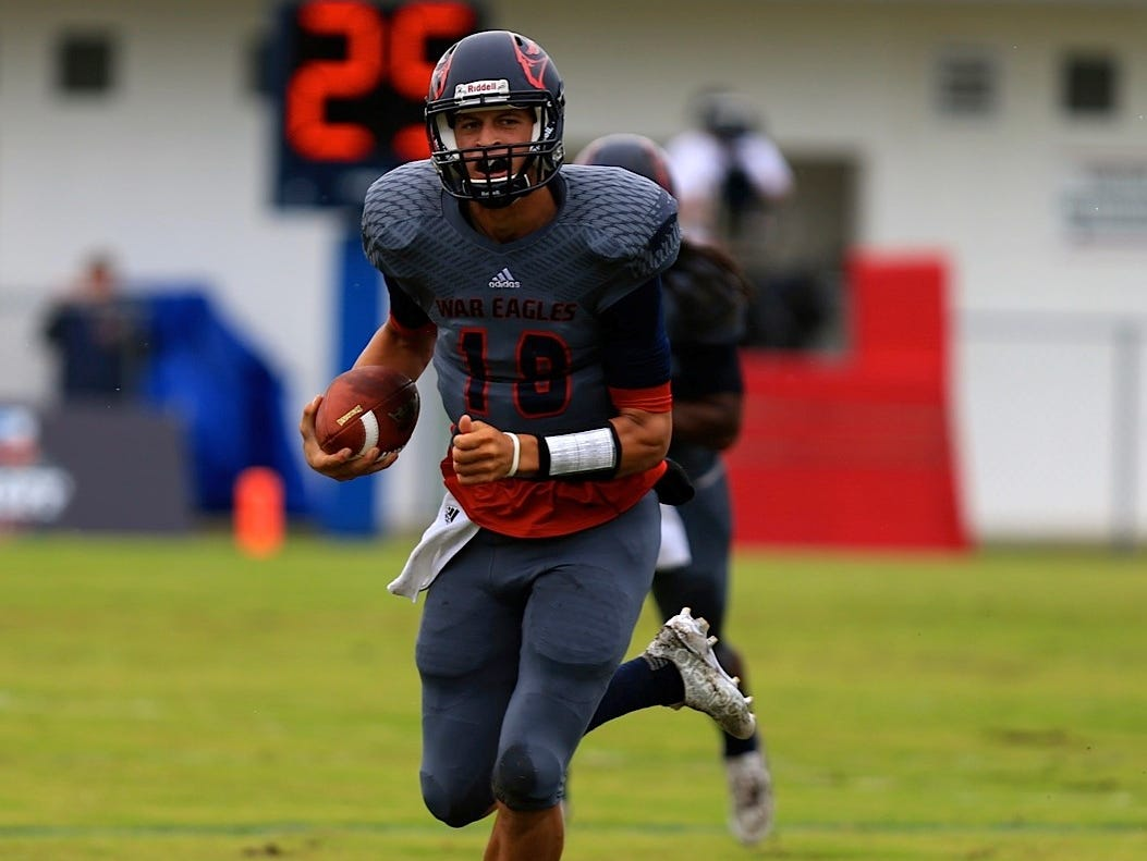 Wakulla quarterback Feleipe Franks runs for a first down in the first quarter of Saturday's game against Spartanburg.