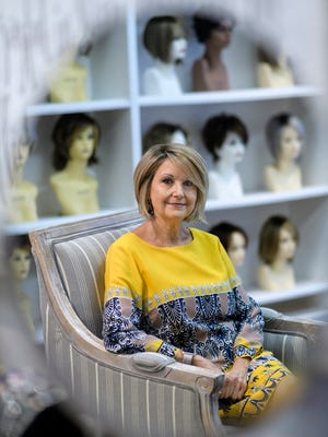 Cathy Bullock, owner of The Cottage Wig Shoppe, sits inside her new shop located on Second Street in downtown Henderson. After retiring from her 31-year job as the Membership Director of the Henderson Family YMCA, she decided to open up the wig shop on May 23, 2018, in honor of both her parents who died from cancer.