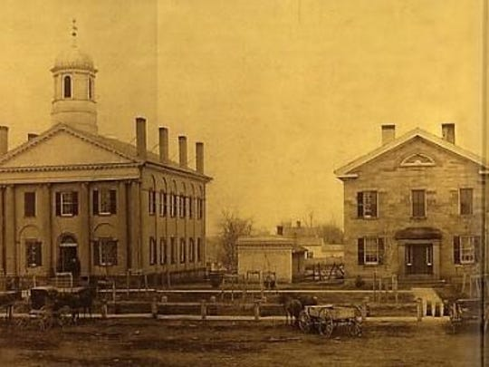 An 1857 photo of the southside of Main Street in Ravenna, Ohio with the Portage County courthouse (left) and the 1837 jail where Reed's brother, Nathaniel, was held charged with the burglary of a grocery store.