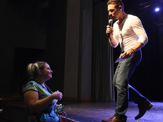Ryan Ray of Los Angeles talks with Stacey Copeland Monday about his recent walk across America during a talk at ASUMH. Ray, who walked through the Twin Lakes Area during his walk, talked about following your dream.