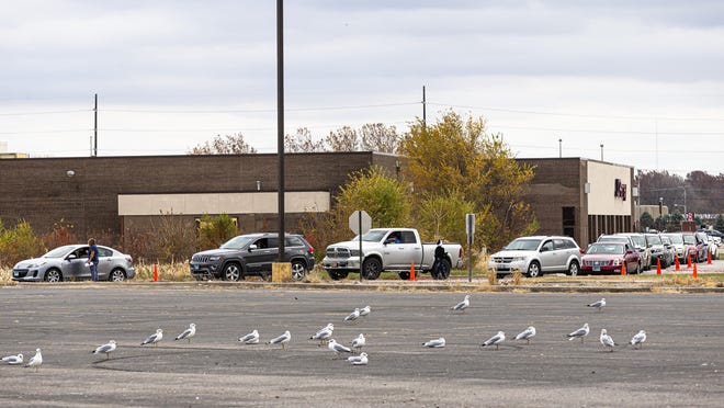 Cars line up into the parking lot of JCPenney for COVID-19 testing at the nearby Sangamon County Department of Public Health, Monday, November 9, 2020, in Springfield, Ill.
