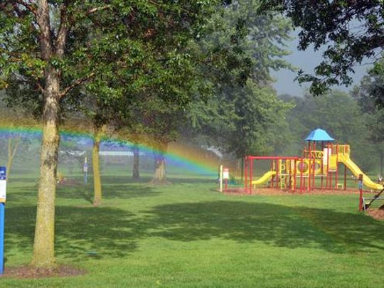 During a grand-opening of a Born Living Trail at Oschwald Park in St. Nazianz Aug. 10, a bright rainbow greeted visitors. Children had fun with the park's new activities despite the rain.