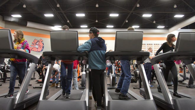 Freshmen Destiny Rankin, left, and Mackenzie Blanchard, right, and others use the treadmills and a variety of other workout stations in the new Brighton High School strength and conditioning facility, which occupies the space formerly used for the old swimming pool.