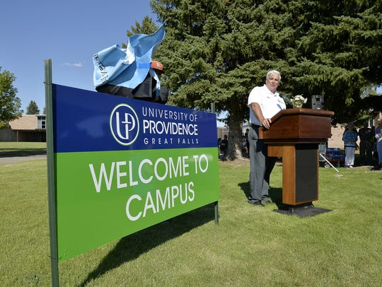 Tony Aretz, president of the University of Providence, formerly the University of Great Falls, unveils the new name and logo during a 2017 ceremony.