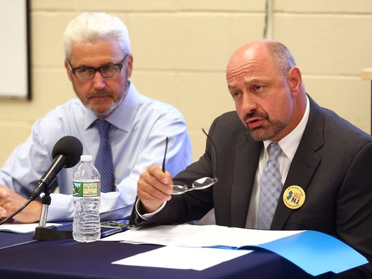 Morristown Mayor Timothy Dougherty, l, looks on as Dover Mayor James Dodd speaks during a Mayoral Roundtable on expanding access to driver's licenses to more residents at Brighton Avenue Community Center in Perth Amboy.  July 19, 2018. Perth Amboy, New Jersey