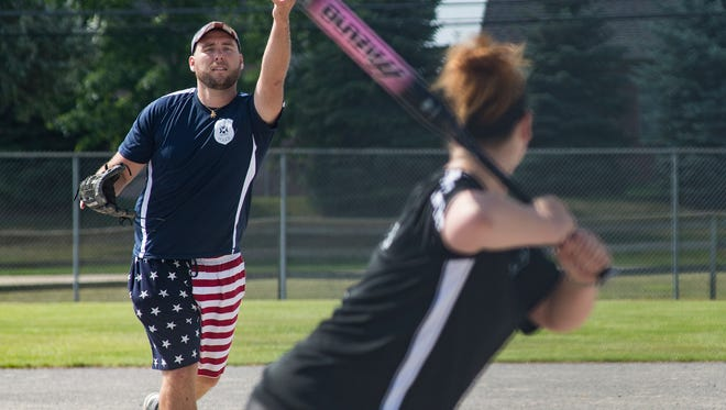 Nathan Kessler of West Bloomfield shows off his pitching skills and his patriotism.