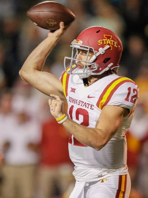 Iowa State quarterback Sam B. Richardson throws the ball against Toledo during the first quarter of an NCAA college football game Saturday, Sept. 19, 2015, in Toledo, Ohio. (Jeremy Wadsworth/The Blade via AP)