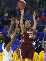 Riverdale's Brinae Alexander (32) goes up for a 3-point-shot