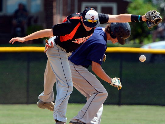 Stoverstown shortstop Brandon Warner falls after colliding