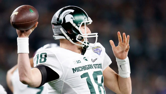 Michigan State Spartans quarterback Connor Cook throws a pass against the Alabama Crimson Tide in the first half in the 2015 CFP semifinal at the Cotton Bowl at AT&T Stadium.