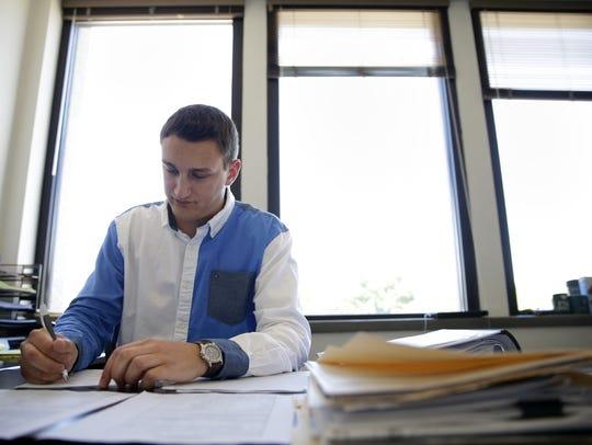 Kevin Englebert, 23, associate planner for Menasha,
