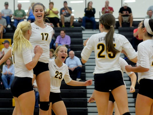 Red Lion's Lindsey Blevins, Jenna Hevner, Lauren Enfield, Emily Sterner and Rachel Groff celebrate a point in the second game in a girls volleyball match last Thursday (Photo by Chris Dunn -- Daily Record/Sunday News)