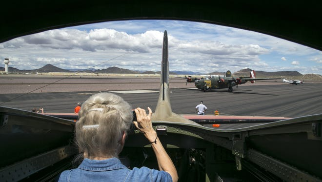 From the interior of a B-17, Cathy Thomas photographs a B-24 as it taxis.