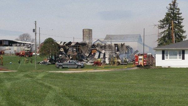 Eleven fire departments from three counties are on the scene of a large barn fire just west of Thornville.