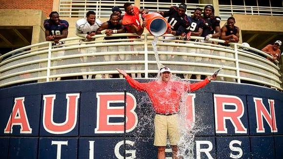Auburn coach Gus Malzahn took part in the ALS Ice Bucket Challenge on Wednesday.