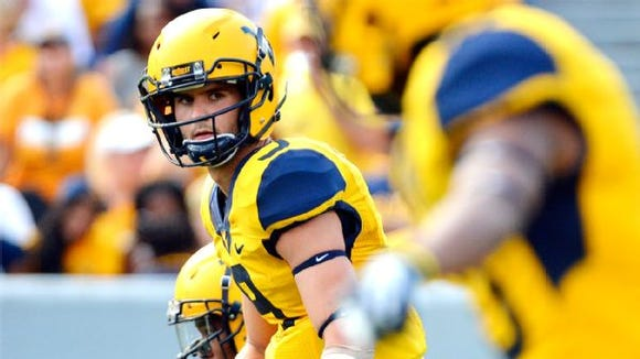 Clint Trickett wishes his former college teammate Jacob Coker luck this season. The two were at Florida State before Trickett transferred to WVU and Coker left for Alabama.