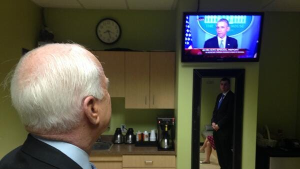 Sen. John McCain watches President Obama's live announcement about  VA chief Eric Shinseki's resignation during a visit to 12 News for an interview on the topic, May 30, 2014.