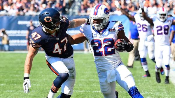Buffalo Bills running back Fred Jackson (22) rushes the ball against Chicago Bears free safety Chris Conte (47) in overtime at Soldier Field.