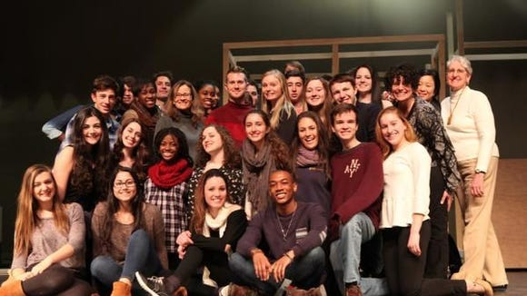 The cast and crew pose for a photo during a break in rehearsals Jan. 29, 2014 for the musical Guys and Dolls at Rye Country Day School. ( Joe Larese / The Journal News )