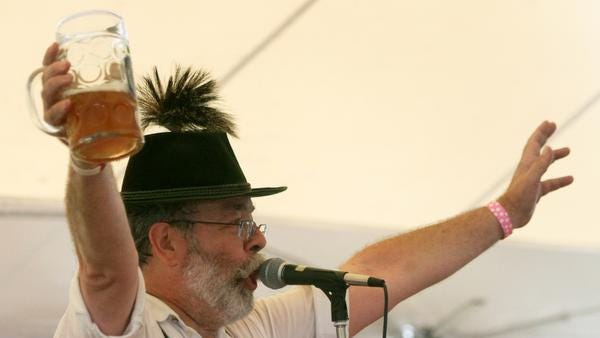 Mark Meuschke of the traditional German band Heidi and Heimat Echo gets attendees to sing along during Oktoberfest celebrations at the Delaware Saengerbund