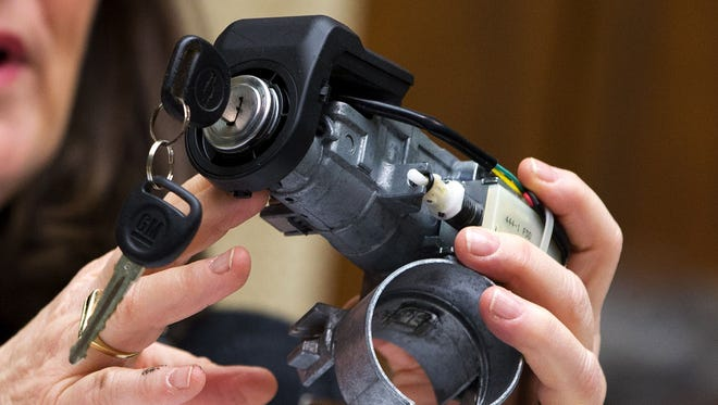 A GM ignition switch is displayed during a hearing in this 2014 file photo