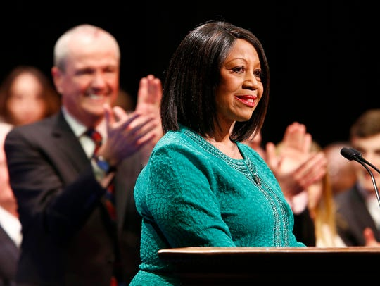 Lt. Gov. Shelia Oliver is applauded by Gov. Phil Murphy after she is sworn into office during a ceremony at the Trenton War Memorial on Tuesday, Jan. 16, 2017.