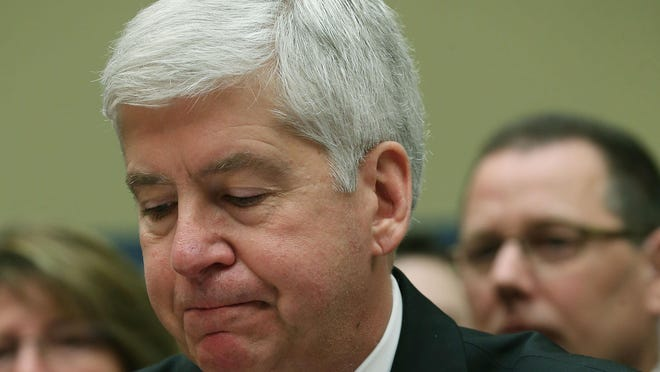 Gov. Rick Snyder, (R-MI), listens to members comments during a House Oversight and Government Reform Committee hearing, about the Flint, Michigan water crisis, on Capitol Hill March 17, 2016 in Washington, DC.