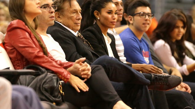 Los Angeles Clippers owner Donald Sterling sits courtside with V. Stiviano during a game against the Utah Jazz at Staples Center in October 2013. (Robert Gauthier/Los Angeles Times/MCT)