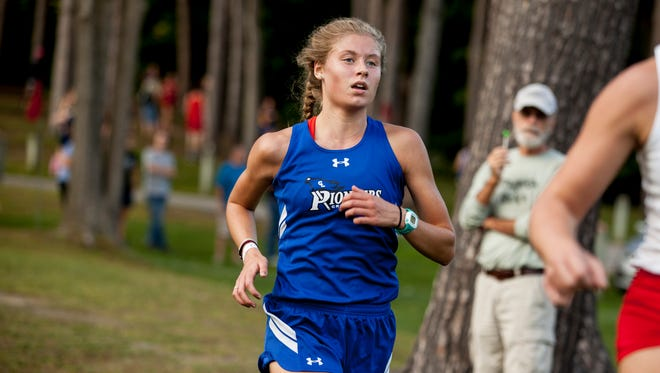 Croswell-Lexington's Calli Townsend runs during an invitational.
