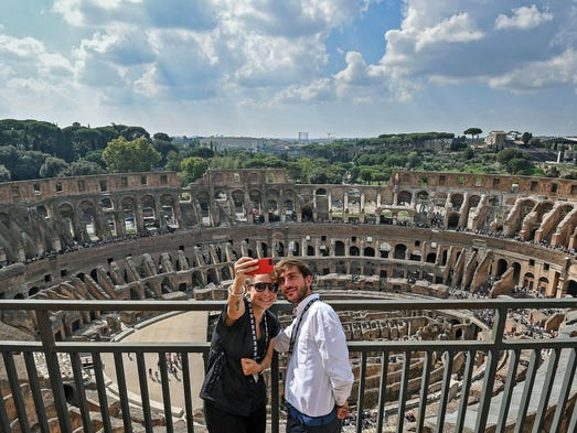 Two visitors take a selfie from the top level of the