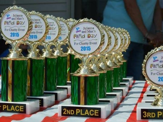 Trophies were awarded to winners of various competitions held during the fifth annual Julianna and Max's Field Day for Charity.