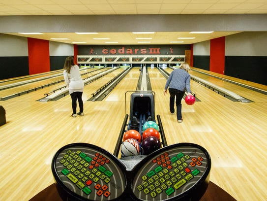 Participants test their skill during the bowling fundraiser