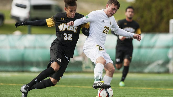 UMBC's Cormac Noael (32) battles for the ball with Vermont's Shane Haley (20) during the men's soccer game between the UMBC Retrievers and the Vermont Catamounts at Virtue Field earlier this season.