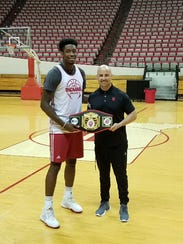 Clif Marshall (right) presents De'Ron Davis with a